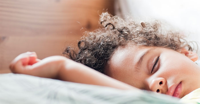 sleeping child with curly hair