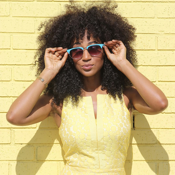 7 Quick Tips To Make Traveling With Curly Hair So Much
