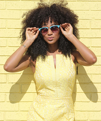 7 Quick Tips That Make Traveling with Curly Hair So Much Easier