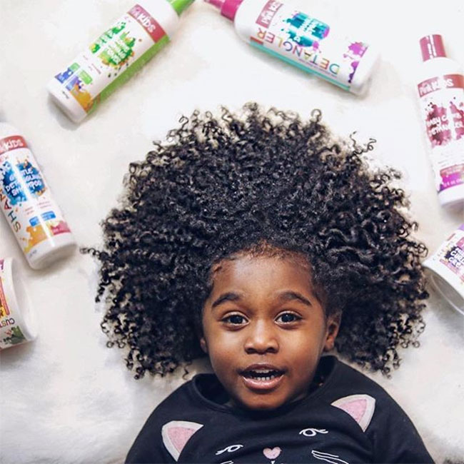 curly kid with luster pink kids products
