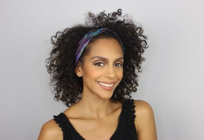 woman with natural hair wearing purple and blue headband